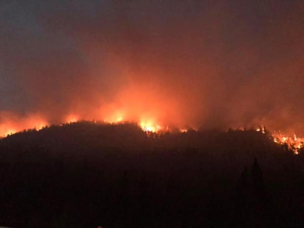 Fire crests the hill by Skyline Trail