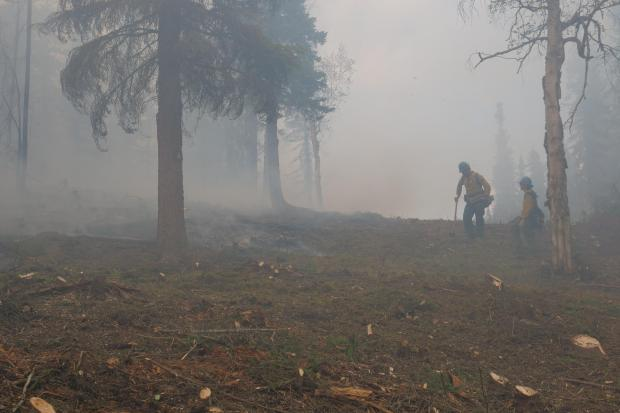 Firefighters in smokey conditions