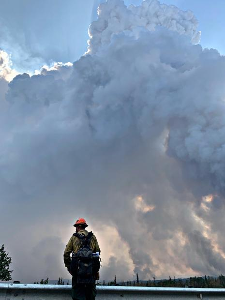A member of a hotshot crew monitors the Swan Lake Fire during burnout operations Monday.