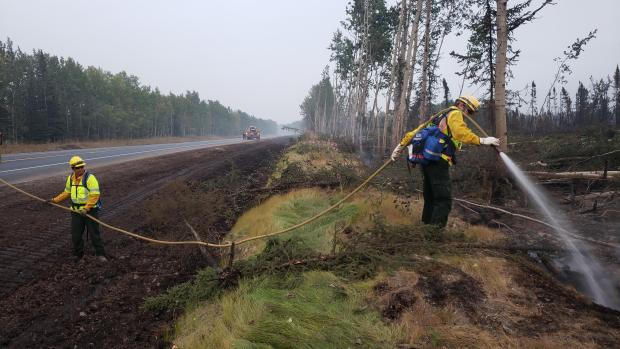 August 29 - Firefighters mopping up hot spots along Sterling Highway