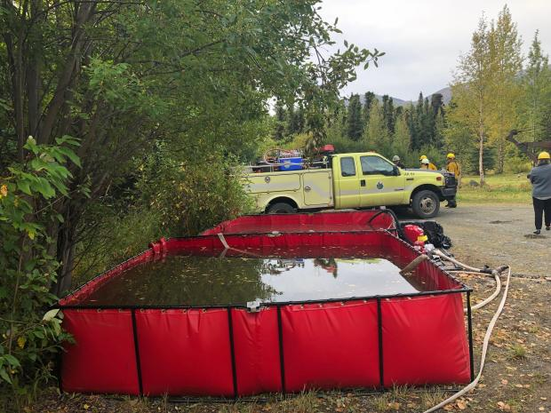 Portable tank next to a fire truck near Hidden Lake Campground