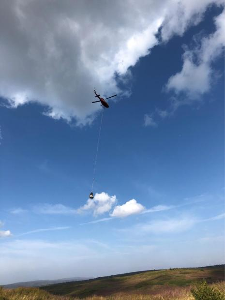 helicopter delivery supplies to crews