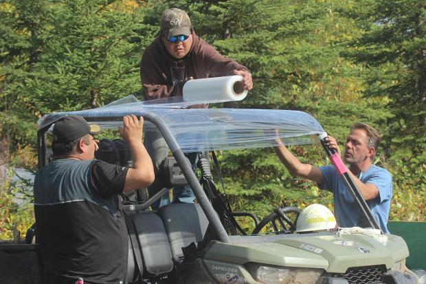 Supply Unit Emergency Firefighters Shrink-Wrap UTV Rooftop. Photo: Mike McMillan - DNR