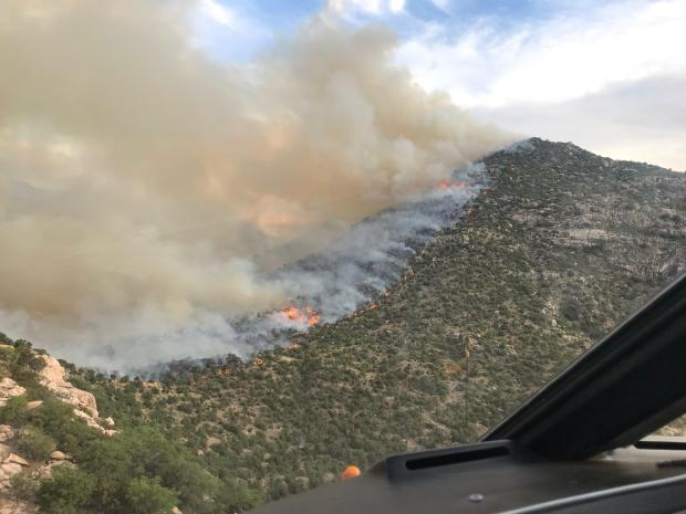 a line of fire moving along Smaniego Peak