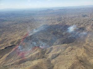 Aerial view of Warsaw Fire area with retardant lining a portion of the fire perimeter