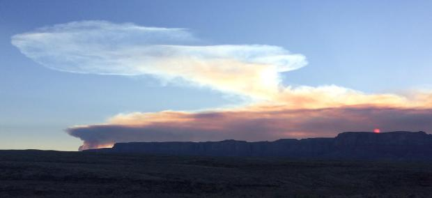 Sun rises behind smoke produced from Mangum Fire June 12, 2020