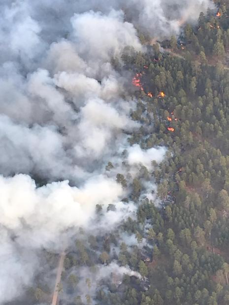 Aerial view of crews conducting burning operations to strengthen the fire perimeter to slop and stop fire spread.