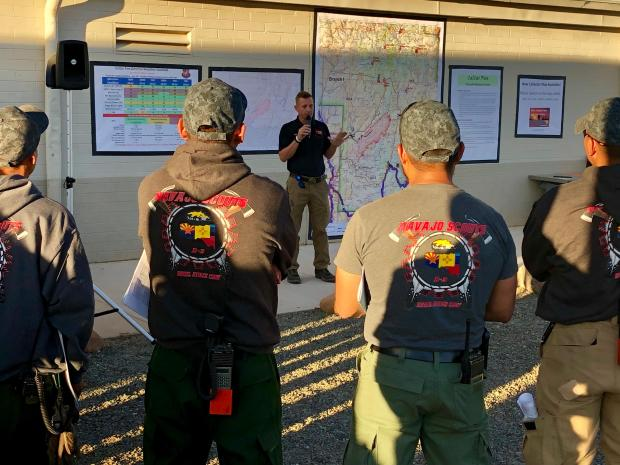 Incident Commander Alan Sinclair provides leader's intent at the morning briefing