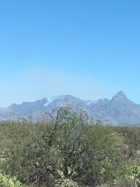 Smoke rises from the mountains southeast of Sell, AZ.