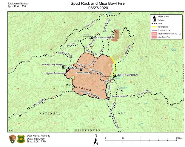 Map showing the Spud Rock Fire in the center with holding and containment lines surrounding.