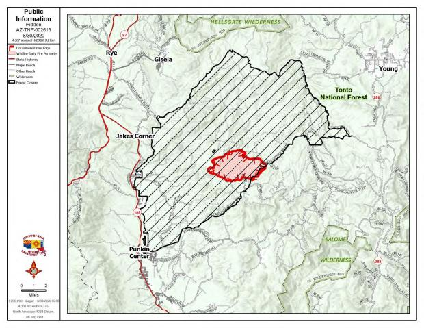 Red perimeter line is uncontained fire line. Cross hatch is closed area. Markings set on a topographical map of the area.