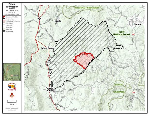 On a background of a topographic map is the fire perimeter with contained fire line in black and uncontained fire line in red. Cross hatch is closed area on the forest.