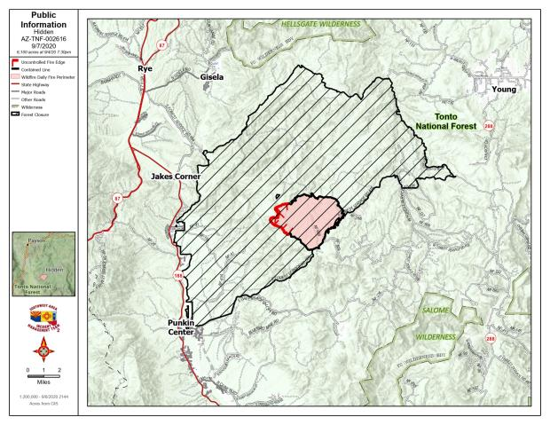 Topographic map with red line on the edge of uncontained fire line and black line around contained fire line. Cross hatch is closed land on the national forest adjoining the fire.