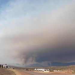 A timelapse shows a wildland fire smoke column building into a plume-dominated fire