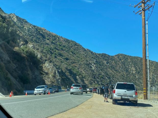 Cars lining up closed HWY 39 on the Dam Fire 8/1
