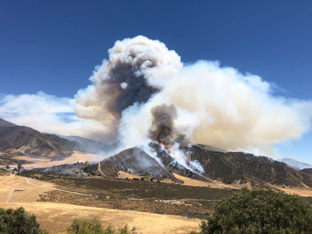 fire and smoke visible on a hill.