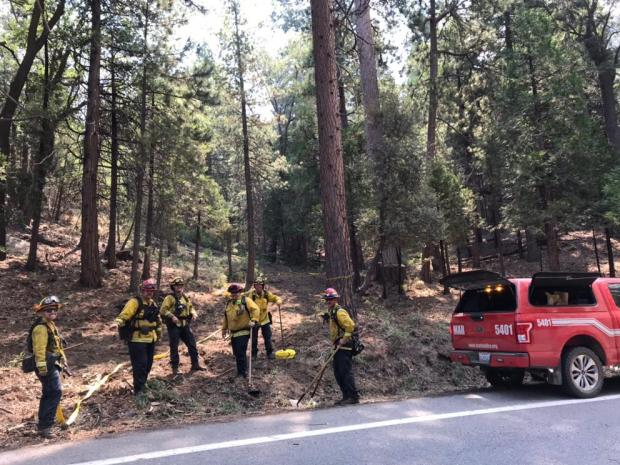 Crews ready themselves to hike up to the firelines along Higwhay 38 NorthEast of Angelus Oaks