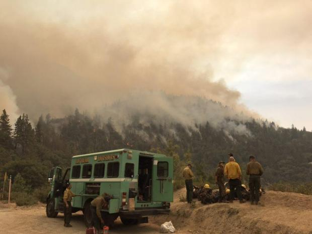 Big Bear Hotshots wait for the fire to drop down to the highway before going to work.