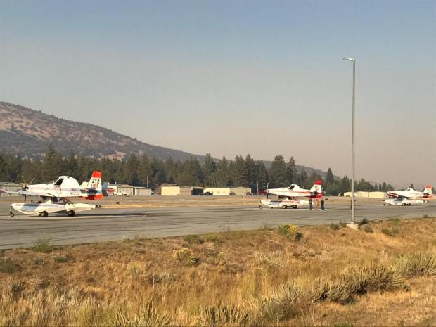 a Fire boss At-802 sits on the runway of the Big Bear Airport.