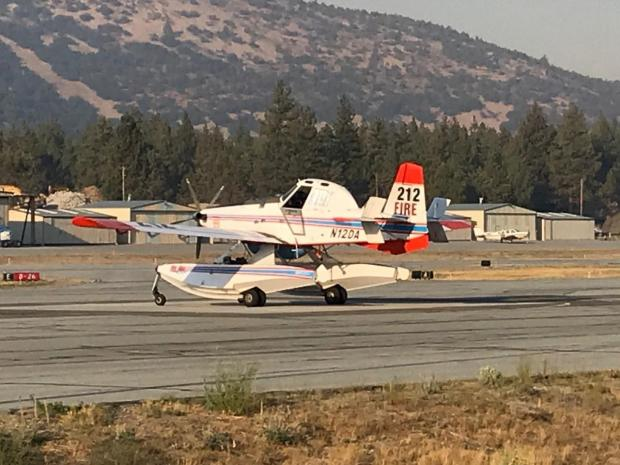 A Fire Boss AT802 sits on the runway of the big bear airport