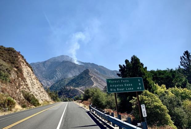 Smoke from the El Dorado Fire in distance seen from Highway 38