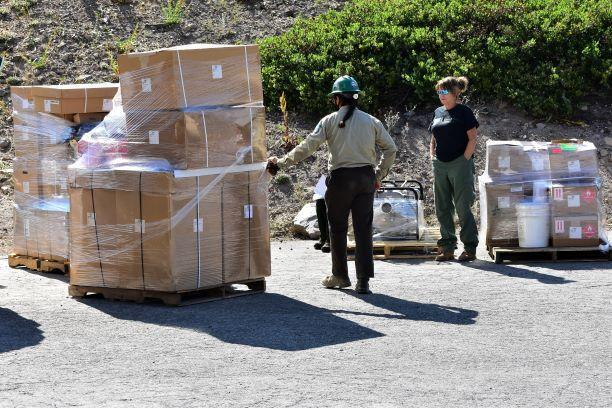 Base camp staff with pallets of supplies