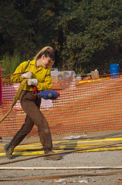 Prepping hose to be rolled back up by California Conservation Corp on 9/21/20