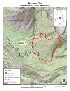 A shaded green map with topographic lines reflecting steep mountains with a red border showing the perimeter of the fire