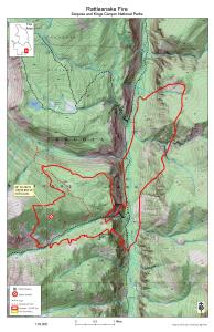 A green shaded map with black concentric lines represents a region of steep mountains with a red border representing the fire perimeter