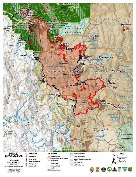 A multi-colored map represents the area burning by using red symbols and lines. Secured fire perimeter is shown in black.