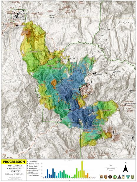 A rainbow of colors represent different temperatures of heat as observed by infrared camera across a mountainous terrain
