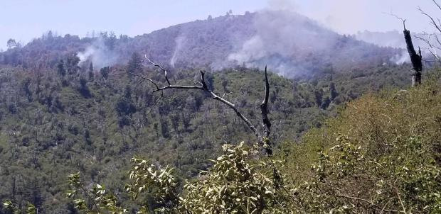 Smoke rises from the burned area