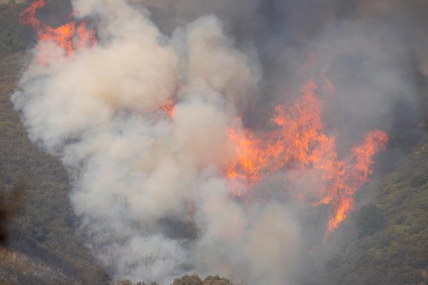 Heavy smoke and large flames are seen burning fuels
