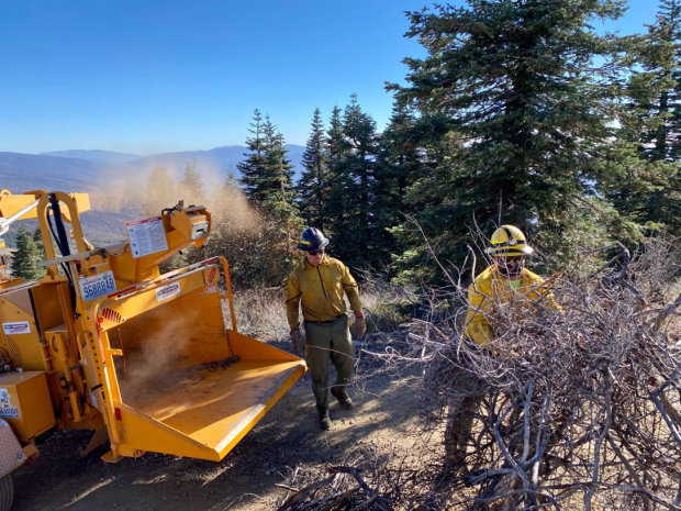 Two firefighters conducting chipping operations Middle Fork of the Eel River October 15