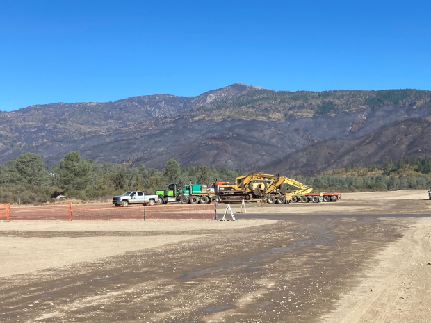 Excavator at Gravelly Spike Camp, located North of Pillsbury Lake,  to be used for suppression repair. Burned landscape in background