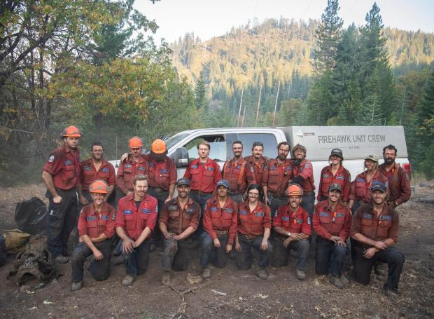 The British Columbia Fire Team brought eleven 20-person hand crews, Here is one of their hard working crews.