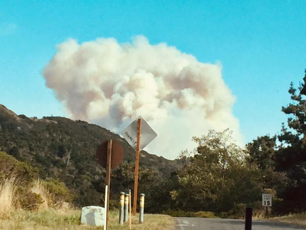 Photo taken by Duffy Hurwin showing the initial smoke plume from the start of the Woodward Fire