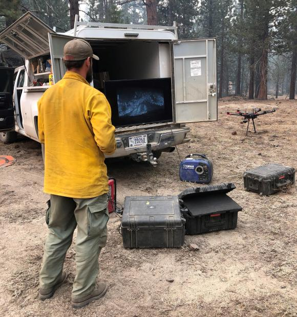 USFS employee preparing to pilot Infrared Drone to detect hot spots along the fires edge to assist fire suppression efforts near Vermillion Camp Ground by Edison Lake. Photo taken October 22 by Derek Tsinger/USFS