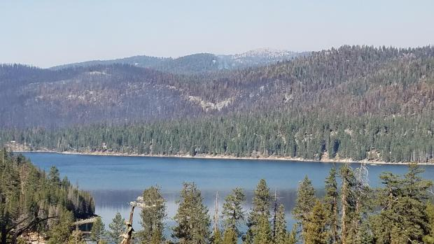 Taken from Rt 168 showing results of suppression efforts to protect shoreline communities and campgrounds on north side of Huntington Lake.  Photo taken October 28 by Dave Stone/USFS