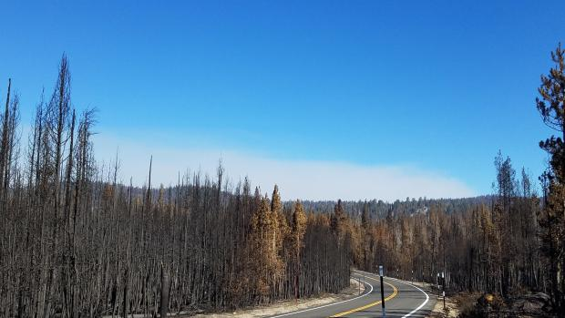 View of early morning smoke on a clear morning from Rt. 168 between Shaver Lake and China Peak towards Thomas A. Edison Lake area on October 28.