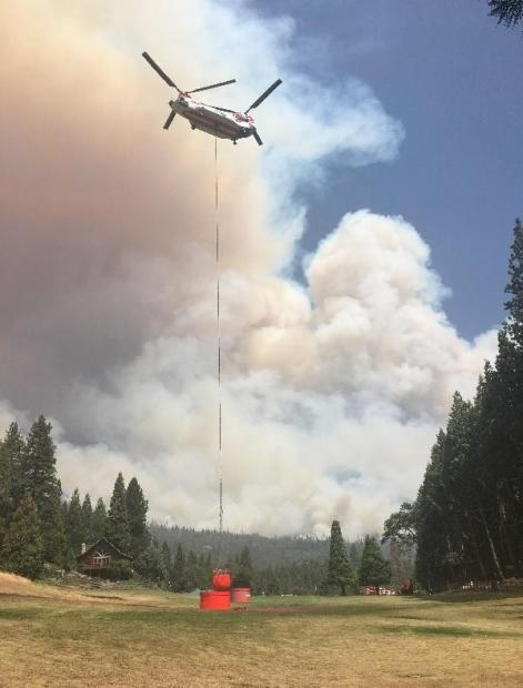 helicopter dips bucket at camp nelson