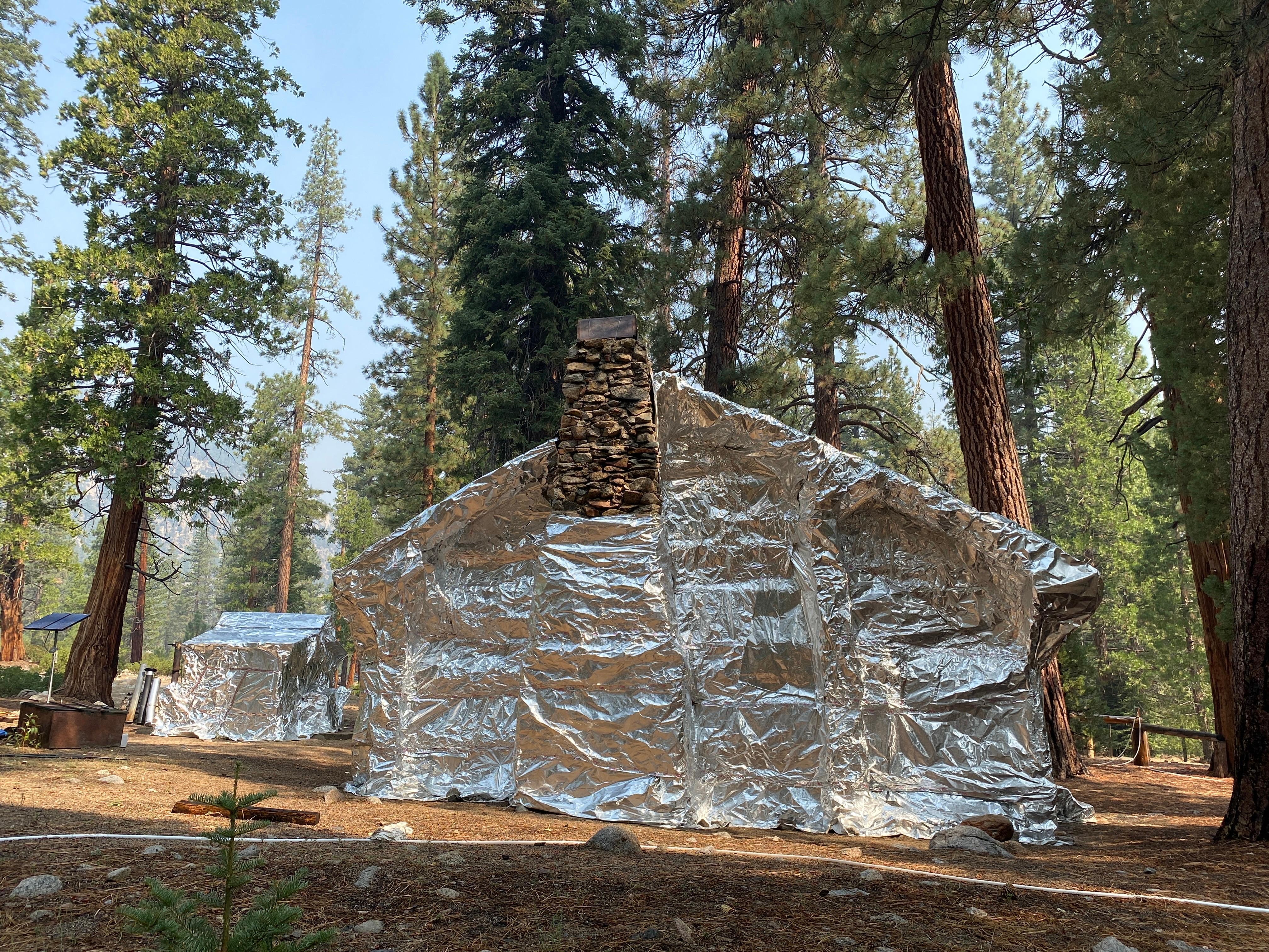 Structure wrapped to protect it from fire