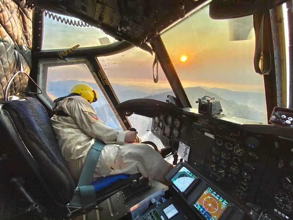 Pilot looking out window at fire.