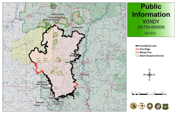 The fire area is in red on a map base, with black and red borders to the fire area showing containment and uncontained line.