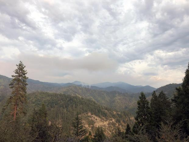 The Red Fire is in the foreground with the white-colored smoke, the large column in the background with the darker-colored smoke is from the Salmon Fire on the Shasta-Trinity National Forest.