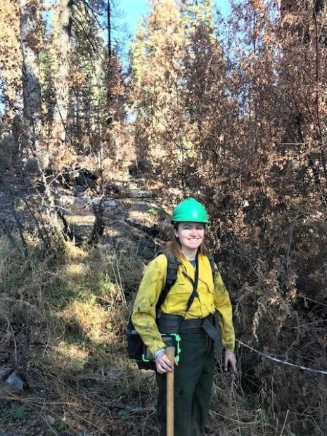 Image showing BAER Specialist Anna Chinchilli in a stream channel looking at additional sediment input from uphill burned area and debris flow potential