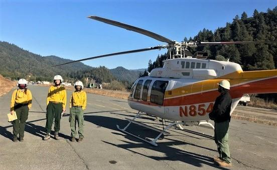 Image showing BAER Specialists Anna Chinchilli, Steve Bachmann, and Kelcy Huston preparing for the helicopter reconnaissance flight