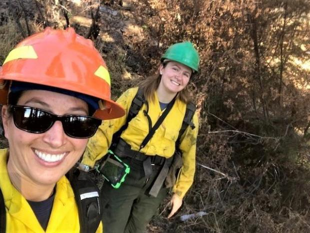 Image showing BAER Specialists Anna Plumb and Anna Chinchilli in the field collecting soil burn severity data and looking at stream channels