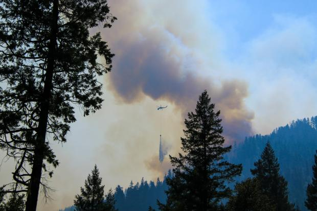 Helicopter dropping water near Elk Creek