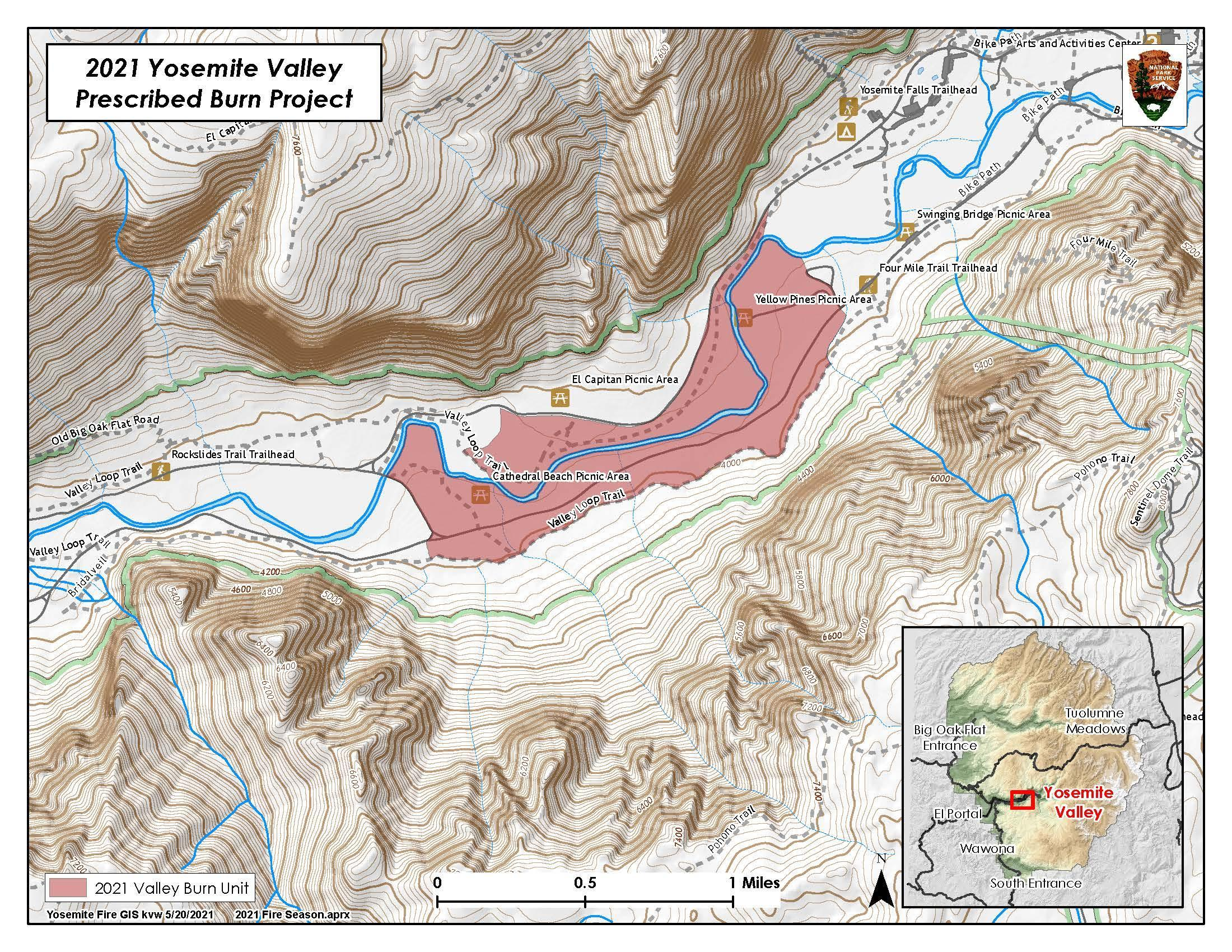 A light brown topography map is overlaid by a long red polygon outlying the burn area on both sides of a river in the middle of the map.